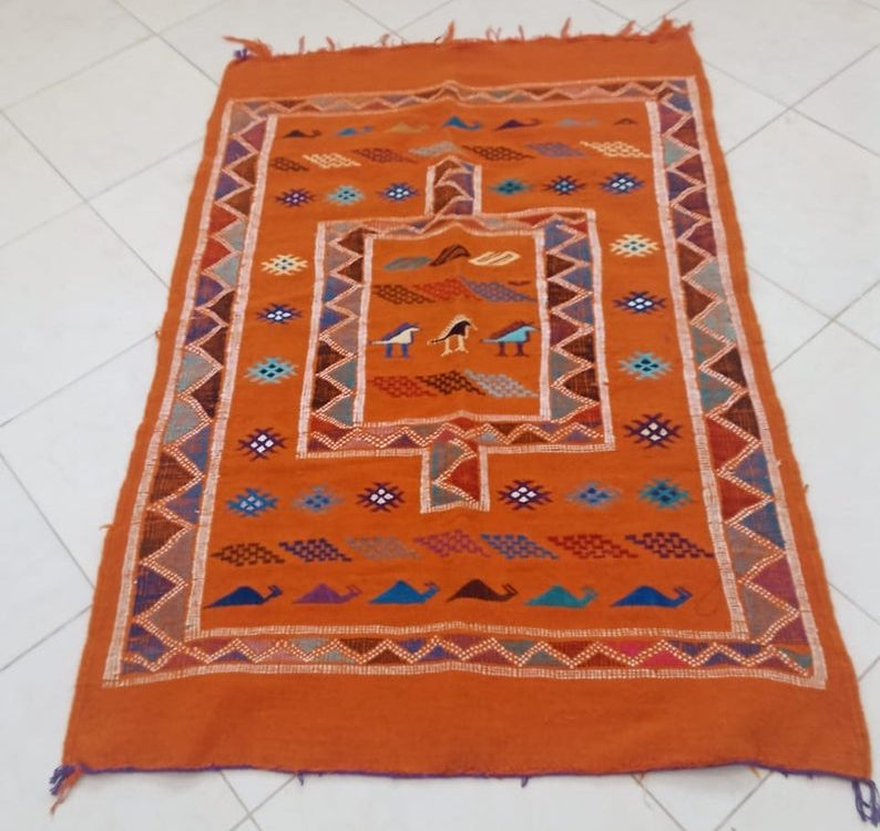 Nomadic moroccan rug gives a boho style to home. orange color Moroccan kilim rug. Handwoved in Morocco
