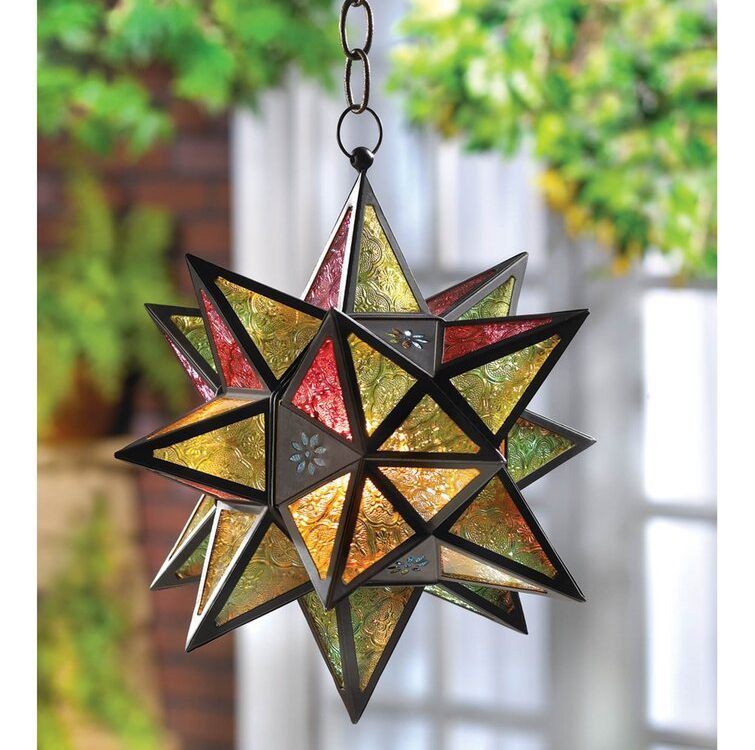 The jewel tone pressed glass panels of this exotic Moroccan-style star candle lantern glow when a candle is lit inside. The dark metal frame is the perfect accent. Not Included: Bulb(s) Features Candle Compatibility: Votive/Tealight Product Details Number of Lights: 1 Fixture Design: Unique / Statement Primary Material: Metal