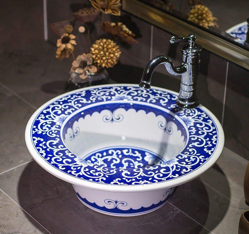 blue and white ceramic wash basin